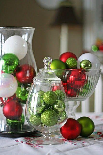 Hurricane jars with ornaments.