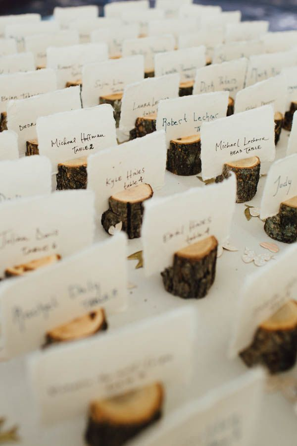 Mini tree stump seating card holders - adorable at this mountain wedding   Photo by Alison Vagnini