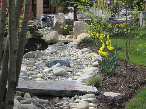Dry river bed with stone bridge Outdoor Landscaping