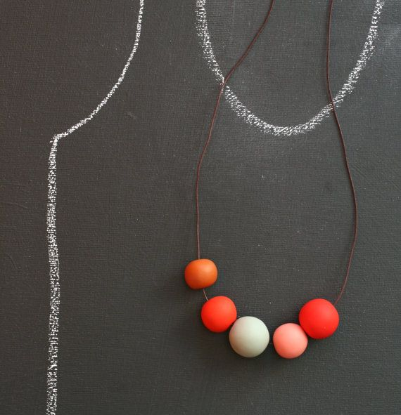 I've been eyeing these clay necklaces for awhile now. hmmm. should I?