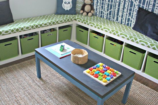 2 IKEA Expedit bookshelves laid sideways with storage bins and matching cushions for a perfect playroom - super cute idea!