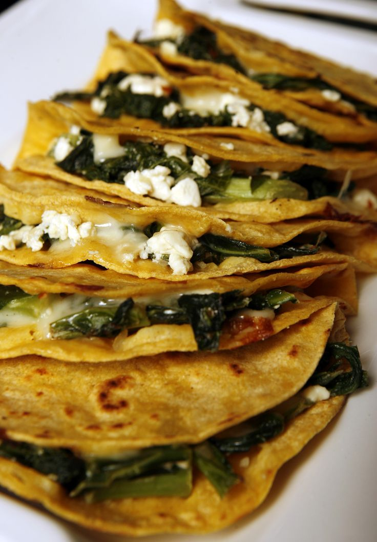 Quesadillas stuffed with greens and feta - id add shredded chicken