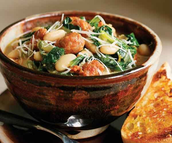 ... today in the crock pot. SO easy and good! Sausage and escarole stew