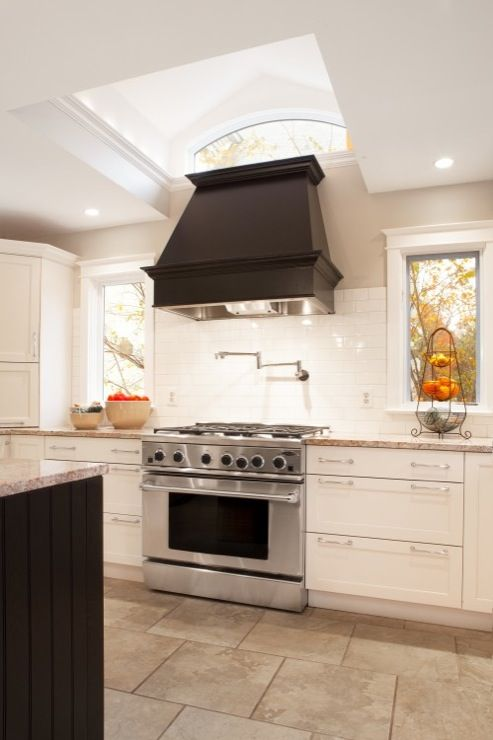 Aidan design kitchens ebony wood panel range hood for Black beadboard kitchen cabinets