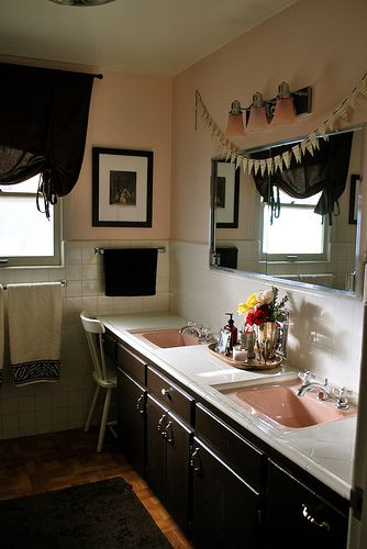 A pink, white & black bathroom -don't like the pink sinks...