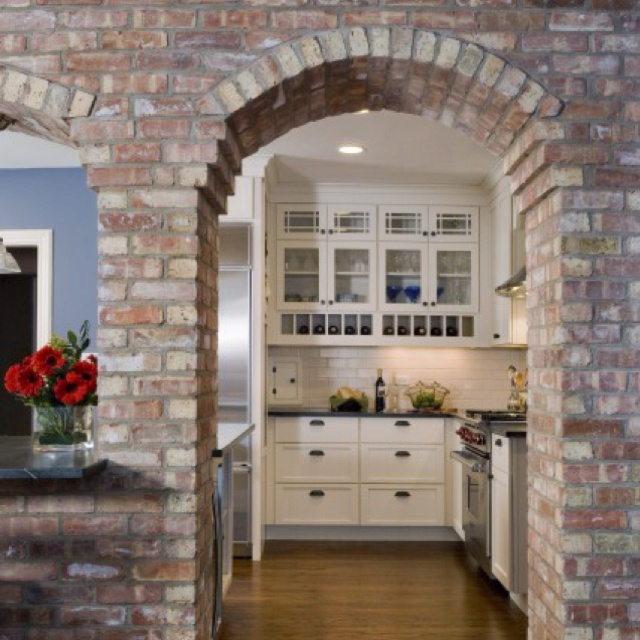 interior stone arch into kitchen k i t c h e n s pinterest