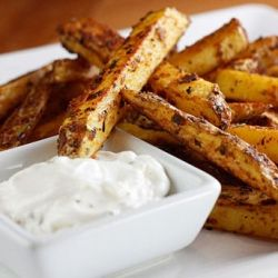 Seasoned baked homemade fries with skinny garlic aioli.. mmmm
