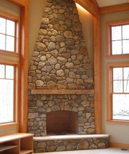 Corner stone fireplace all wall high for the home Corner rock fireplace designs
