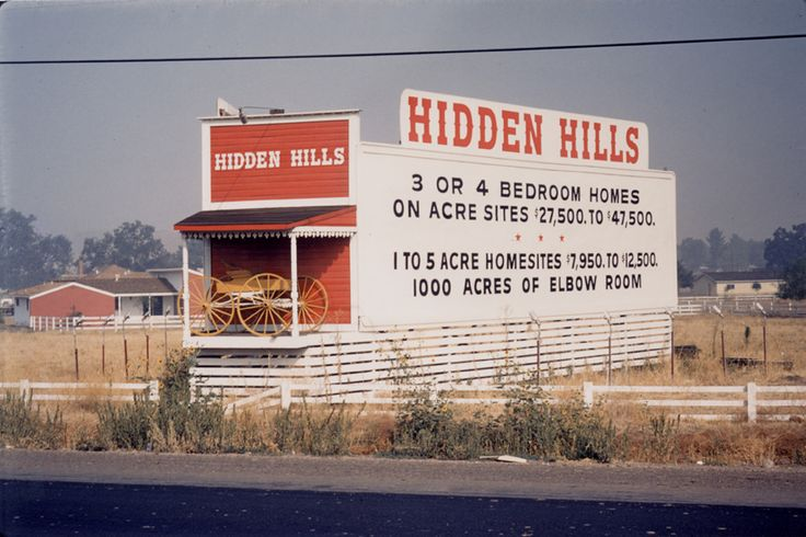 Billboard advertising housing and land availability located at the front entrance to the Hidden Hills development, April 1957. Calabasas Historical Society. San Fernando Valley History Digital Library.