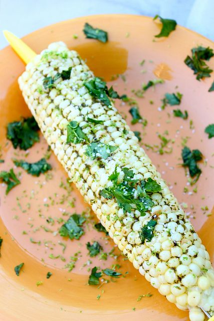 Grilled corn on the cob with cilantro lime butter.. messy but worth it ...