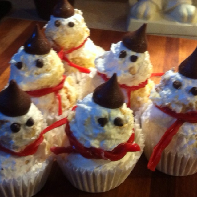 Coconut snowmen with Hershey's hats. Looks sort of a la cone heads or ...