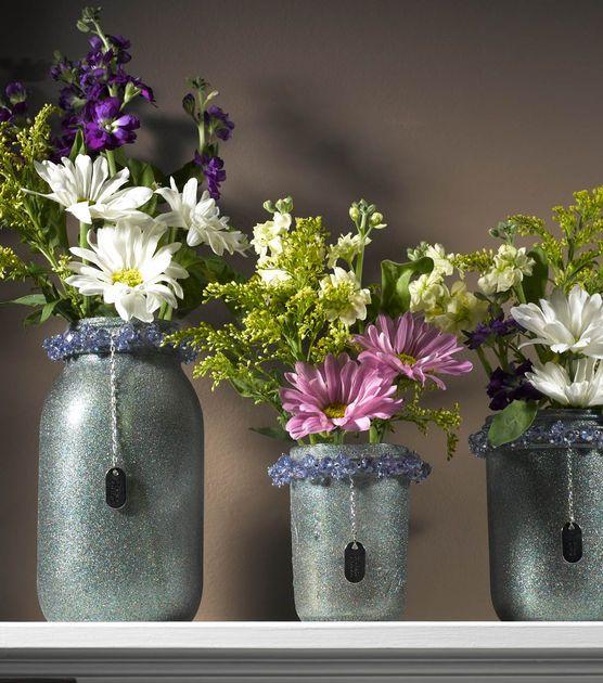 We love to mason jar crafts! Just add Krylon Glitter Blast to this #DIY glitter vase.