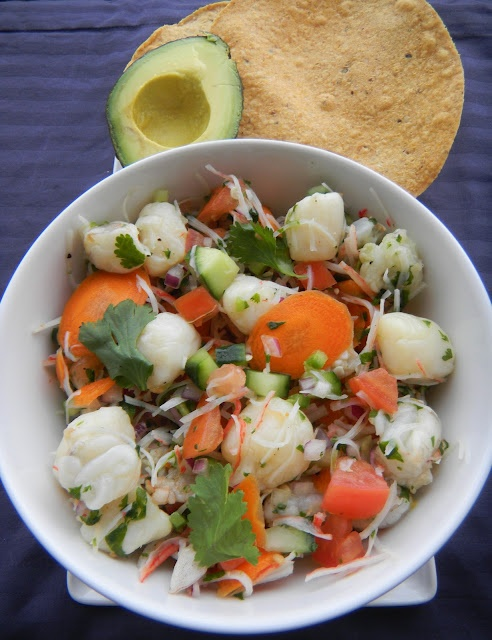 ... , scallop, and imitation crab served with fresh avocado on tostadas
