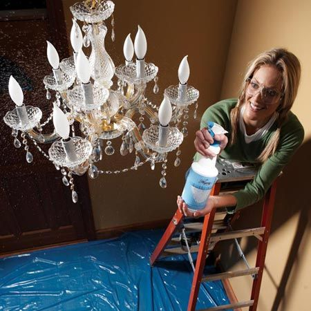 Use chandelier cleaning spray. It rinses off dust and the solution that's left evaporates quickly and doesn't leave water spots.