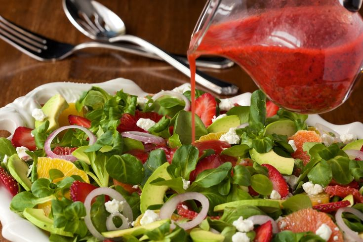 Citrus salad with strawberry poppy seed dressing