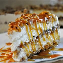 """Butter Brickle Frozen Delight   """"A graham cracker crust is topped with layers of sweetened cream cheese and a pecan oat crumble and snaked throughout with caramel sauce. Frozen and served cold."""" THIS IS SOOO GOOD!!!!"""