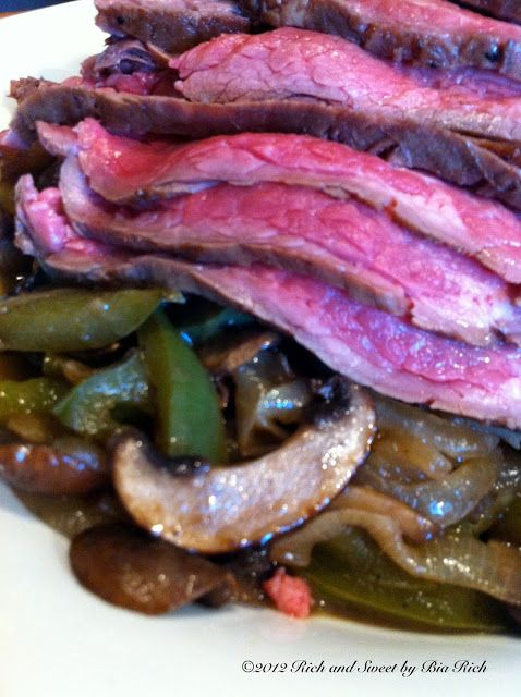 Marinated Grilled Flank Steak over Caramelized Onions, Peppers and ...