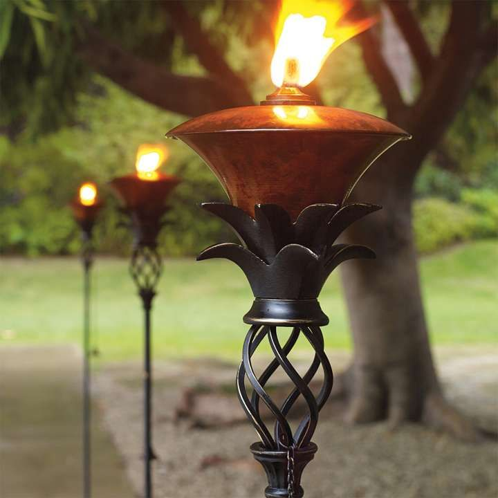 Pineapple torches for the home pinterest for Outdoor tiki torches