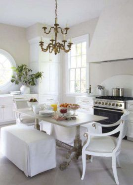 VERANDA simple kitchen, yet stunning at the same time. Bench seating, chandelier