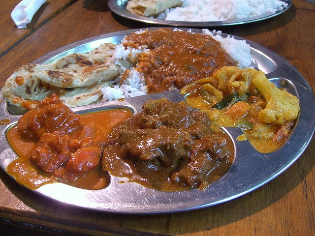 Butter Chicken, Lamb Curry, Masala Vegetables, rice, roti