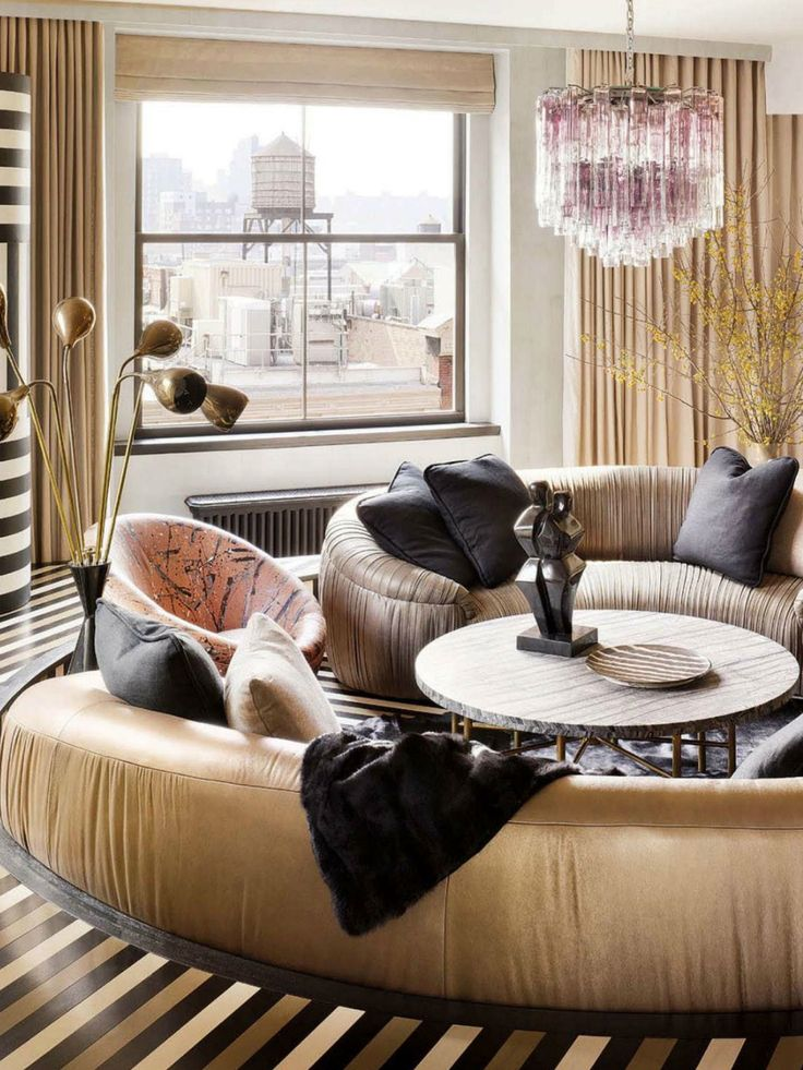 Kelly Wearstler -- love her use of stone, brass and a chic chandelier  Living room furniture: Trends for 2015 590c6c04ee769ee192b452b43e20df6a