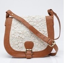 this brown leather handbags is cute.