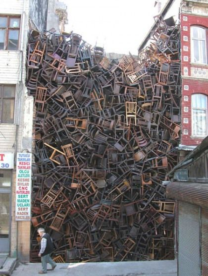 """""""1550 Chairs Stacked Between Two City Buildings"""" location based installation by artist Doris Salcedo (2003) for the Istanbul Biennial. From Warholian"""