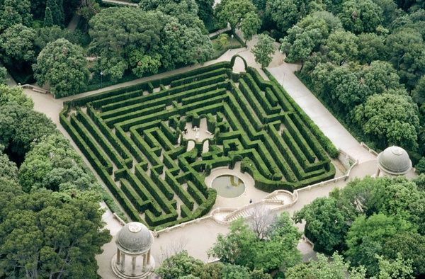 """The Horta Maze (Barcelona, Spain) was created when a Catalan aristocrat decided to convert an old, extensive family property at the end of the 18th century. The garden's layout, buildings and ornamentation were designed by Bagutti – an Italian architect – and Delvalet – a French gardener.""    Gorgeous high view of Horta maze."