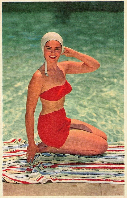 Great pairing of striped towel and lipstick red two-piece swimsuit. #vintage #swimming #pool #summer #bathing_suit #swimsuit