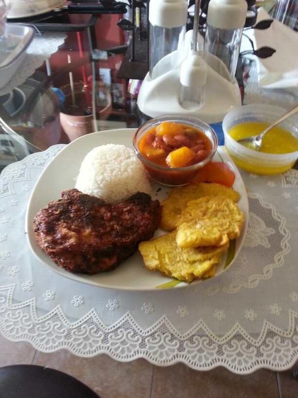 White rice, beans, with breaded pork chops and tostones with garlic ...