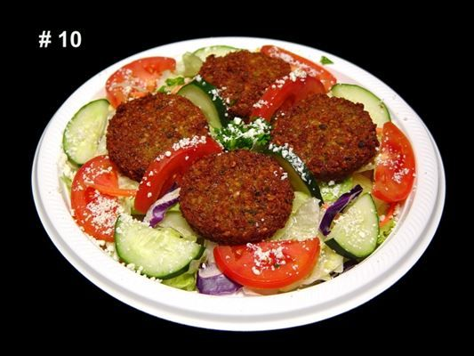 Falafel Salad :Mixed lettuce, tomato, cucumber, feta cheese and four ...
