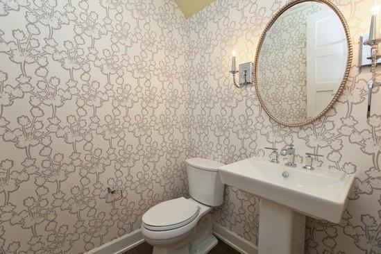 Wallpaper powder room/ sconces / round mirror
