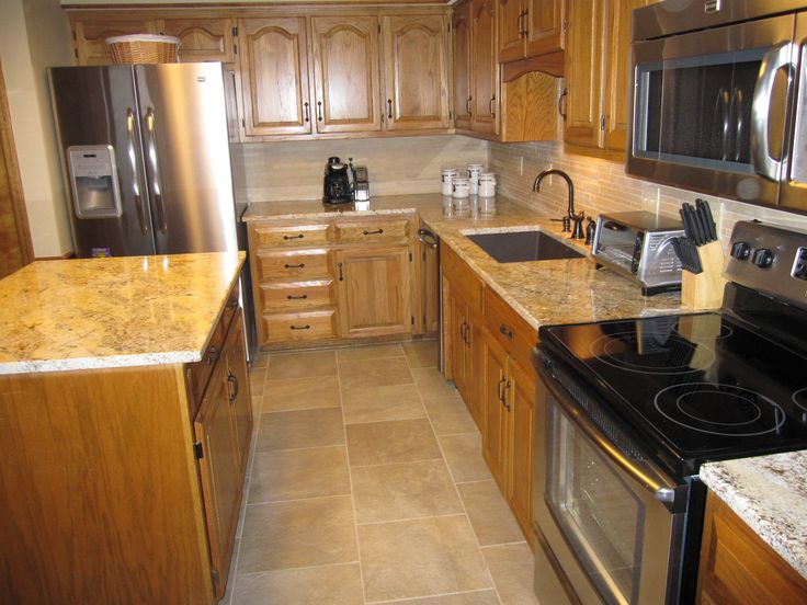 , refinished existing oak cabinets, added oil rubbed bronze hardware