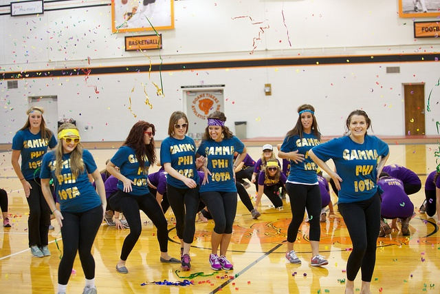 Of gamma phi iota perform their homecoming skit at the pep rally