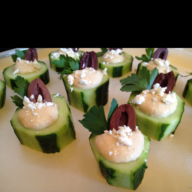... filled with hummus, garnished with kalamata olives and feta cheese