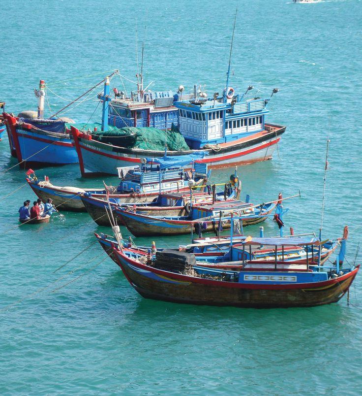Fishing boats float off the coast of Vietnam.