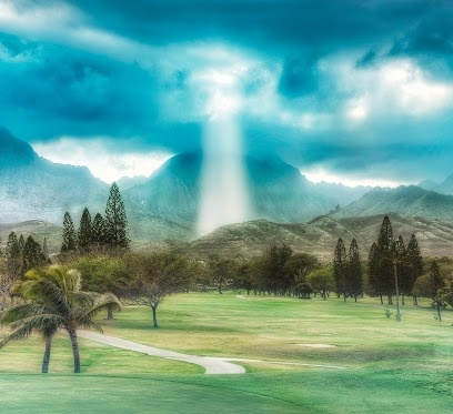 A ray of light shining down through the clouds / Kailua, Hawaii