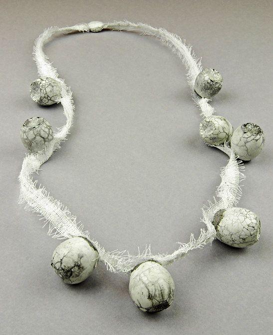 Anja Eichler - Concrete Fragility - Bandaged -   Quail eggs, concrete, bandage, steel wire
