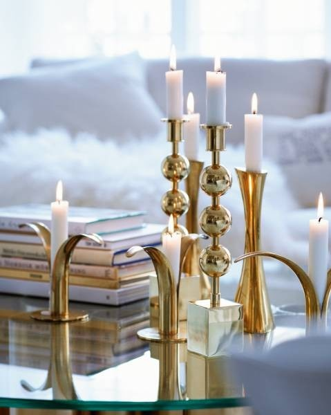 Brass candlesticks and old books