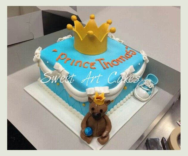 baby shower cake with rolled fondant bear and shoe gumpaste crown