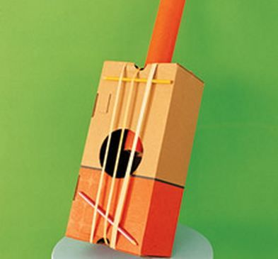 Banjo made out of shoe box, rubber bands, mailing tube--door prize?