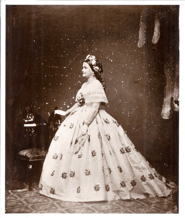 Mary Todd Lincoln full figure profile portrait by Mathew Brady Studio.