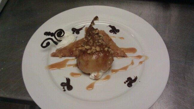 Vanilla bean stuffed Poached pear, baklava and caramel sauce