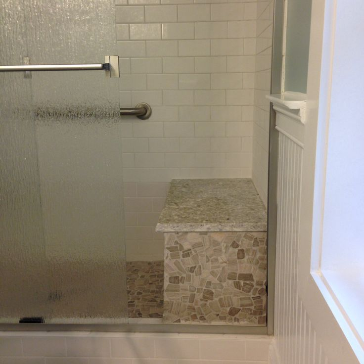Flat mosaic stone floor and bench sides basco sliding glass doors and