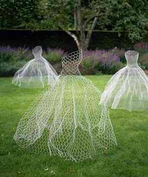 "ghostly dancing dresses.  These seem to be made from bent chicken wire ""fabric"" cut and formed to dress shape, then spray-painted white."