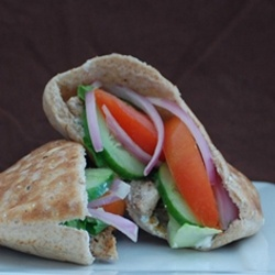 Chicken Shawarma - Pita bread stuffed with spiced chicken, veggies, and a dill yogurt sauce