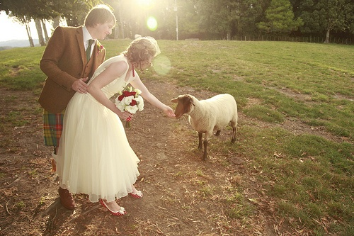 "This picture is just too perfect with that sweet baby lamb. Perfect farm/barn wedding venue ""accessory!"" ... And can I just say how much I love the groom's kilt and the bride's red and white polka dot peep toe shoes?! Because they're awesome."