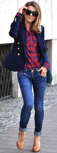Classic navy blazer with gold buttons, plaid shirt, jeans.
