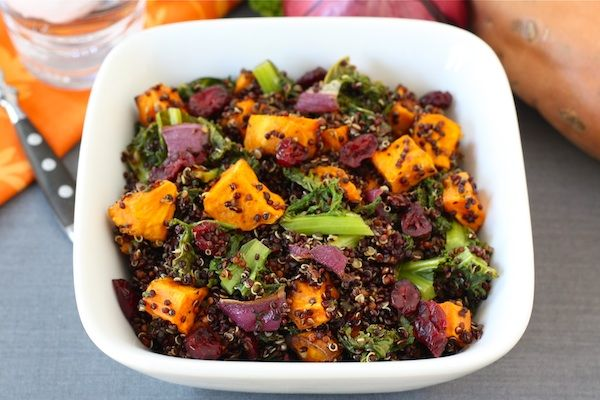 Quinoa, sweet potatoes, kale, red onion, dried cranberries drizzled with balsamic vinegar. YUM!