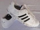 Unworn ADIDAS shell toe sneakers signed by De Le Soul